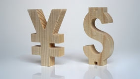 Exchange rating. Currency sign Yen, Dollar. Exchange rating. Currency wooden sign yen and dollar stock photography