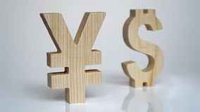 Exchange rating. Currency sign Yen, Dollar. Exchange rating. Currency wooden sign yen and dollar royalty free stock photo
