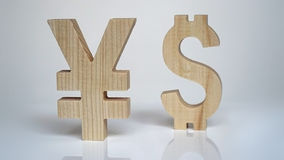 Exchange rating. Currency sign Yen, Dollar. Exchange rating. Currency wooden sign yen and dollar royalty free stock images
