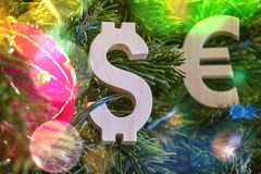 Exchange rating. Euro, Dollar on Green Christmas tree with red vintage ball decorations Stock Photo