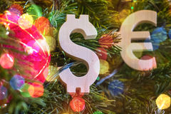 Exchange rating. Euro, Dollar on Green Christmas tree with red vintage ball decorations Royalty Free Stock Image