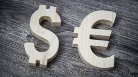 Exchange rating. Euro, Dollar on wooden wall. Exchange rating. Currency sign euro and dollar royalty free stock photography