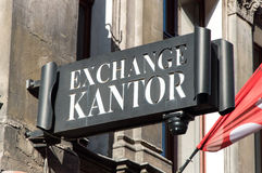 Currency exchange. Sign of currency exchange on the wall Stock Image