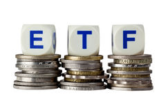 Exchange Traded Fund. Stacks of coins with the letters ETF isolated on white background Stock Photo