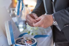 Exchange of Wedding Rings ahnd in hand royalty free stock photo