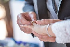 Exchange of Wedding Rings ahnd in hand royalty free stock images