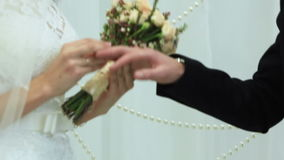 Exchange of wedding rings. Two white people groom and bride exchange wedding rings stock footage