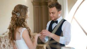 Exchange wedding rings stock video footage