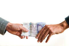 Exchanging british money pounds sterling Royalty Free Stock Photo
