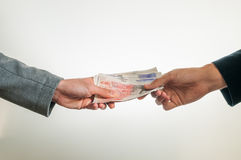 Exchanging british money pounds sterling Royalty Free Stock Image