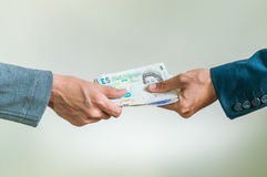 Exchanging british money pounds sterling Royalty Free Stock Images