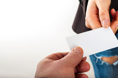 Exchanging business card with business partner Royalty Free Stock Image