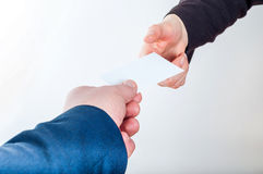 Exchanging business card with business partner Stock Images