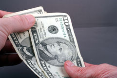 Exchanging Cash. This is a close up image of two hands exchanging cash royalty free stock images