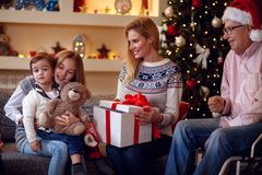 Exchanging Christmas Gifts–family at Christmas opening gifts t Stock Image