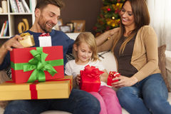 Exchanging Christmas gifts. Happy family opening christmas presents at home Stock Image