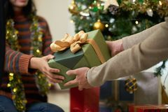 Exchanging Christmas present stock images