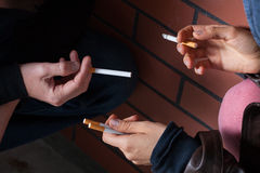 Exchanging cigarettes closeup Stock Image