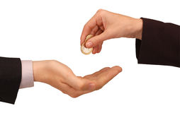 Exchanging coins. Businesswoman exchanging coins by hand to a businessman stock photos