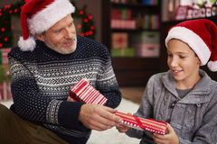 Exchanging gifts with dad Royalty Free Stock Photos