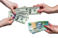 Exchanging money between american dollar and Australian dollar isolate. On white royalty free stock photos