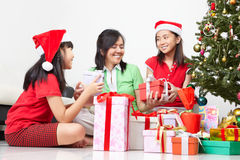 Exchanging present on Christmas Stock Images