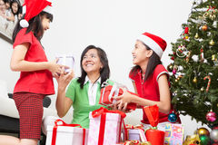 Exchanging present on Christmas Stock Photography