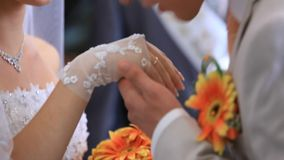 Exchanging Rings. Bride and groom exchanging rings on the wedding ceremony stock footage