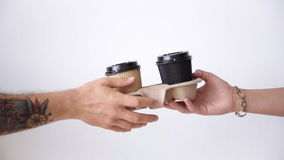 Exchanging take away paper cups in center, sale concept stock footage