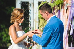 Exchanging of Wedding Rings. Exchange of wedding rings at ceremony Royalty Free Stock Photography