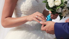 Exchanging of wedding rings stock footage