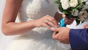 Exchanging of wedding rings stock footage