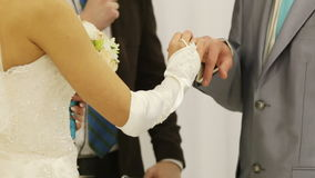 Exchanging wedding rings. Two white people groom and bride exchange wedding rings stock video