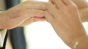 Exchanging of wedding rings. Two white people groom and bride exchange wedding rings stock footage