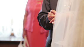 Exchanging of wedding rings. Two white people groom and bride exchange wedding rings stock video footage