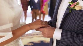 Exchanginge of wedding rings. Two white people groom and bride exchange wedding rings stock video