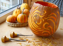 Excision from the pumpkin of lantern on halloween Stock Photos