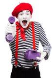excitado imite dando el teléfono inmóvil retro ultravioleta foto de archivo