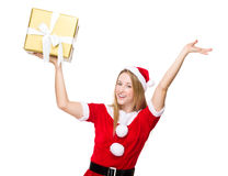 Excite woman with Christmas gift Royalty Free Stock Images