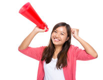 Excite woman happy with megaphone. Young woman isolated on white Stock Photo