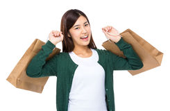 Excite woman hold with shopping bag. Asian Woman isolated on white Stock Photos
