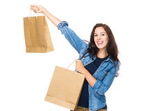 Excite woman hold shopping bag. Isolated on white background Royalty Free Stock Photos