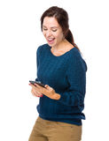 Excite woman look at cellphone Stock Photos