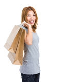 Excite woman with shopping bag. Isolated on white background Stock Images