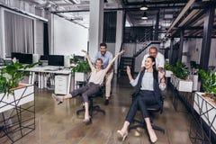 Excited бизнесмены на стульях Стоковое Изображение RF
