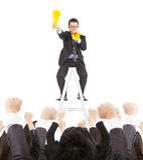 Excited бизнесмен ободряет с мегафоном приветственного восклицания для того чтобы объединяться в команду Стоковое Изображение RF