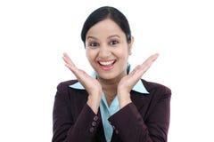 Excited бизнес-леди против белизны Стоковая Фотография