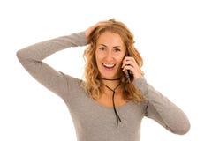 Excited молодая бизнес-леди говоря на умном телефоне изолировала ove Стоковое фото RF