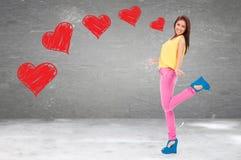 Excited молодая женщина находясь в влюбленности Стоковое Изображение