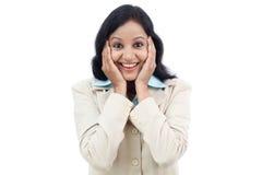Excited молодая бизнес-леди против белизны Стоковые Изображения RF